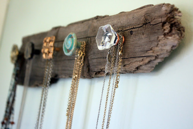 DIY driftwood necklace holder made with decorative knobs, with jewelry hanging, a perfect DIY rustic farmhouse home decor project when you're on a tight budget