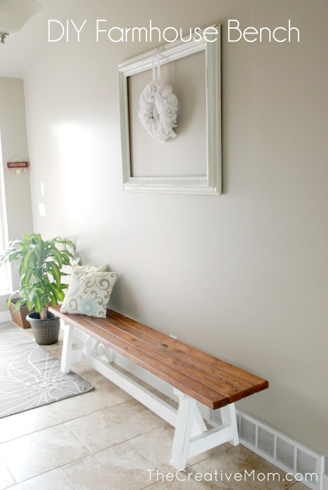 DIY farmhouse bench with stained top and white bottom, in entryway, with pillows, a perfect DIY rustic farmhouse home decor project when you're on a tight budget