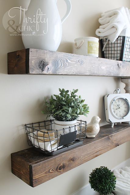 DIY stained floating shelves with ceramic pitcher, wire baskets, antique clock,, a perfect DIY rustic farmhouse home decor project when you're on a tight budget