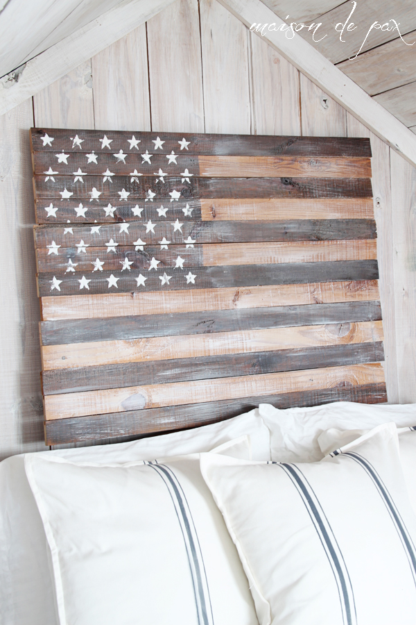 DIY Planked American Flag in rustic farmhouse bedroom above bed, a perfect DIY rustic farmhouse home decor project when you're on a tight budget