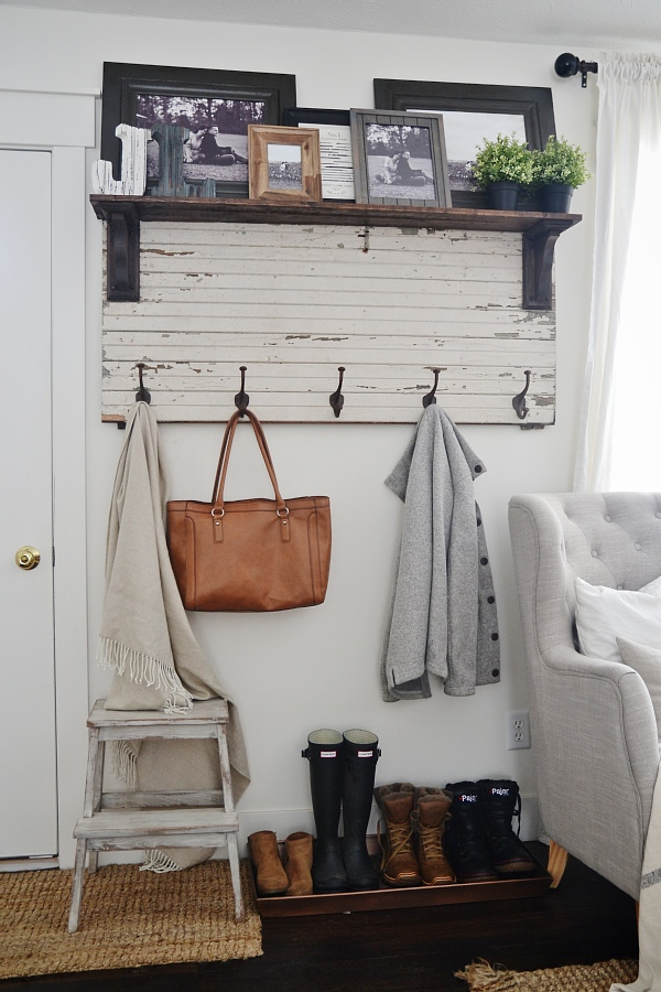 DIY rustic coat rack with shelf above staged with pictures, bags, shoes at entryway, a perfect DIY rustic farmhouse home decor project when you're on a tight budget