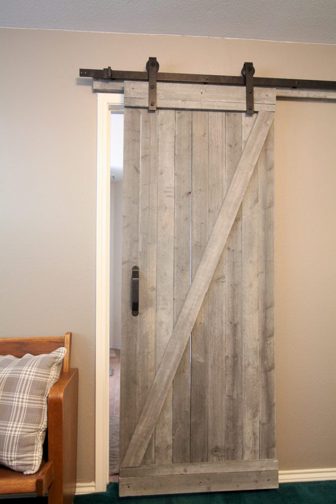 DIY farmhouse sliding barn interior door, a perfect DIY rustic farmhouse home decor project when you're on a tight budget