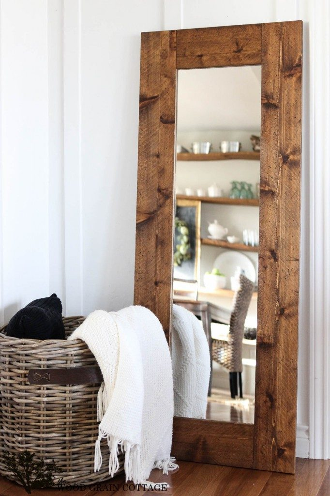 DIY rustic wood mirror with basket of blankets, farmhouse decor in reflection, a perfect DIY rustic farmhouse home decor project when you're on a tight budget
