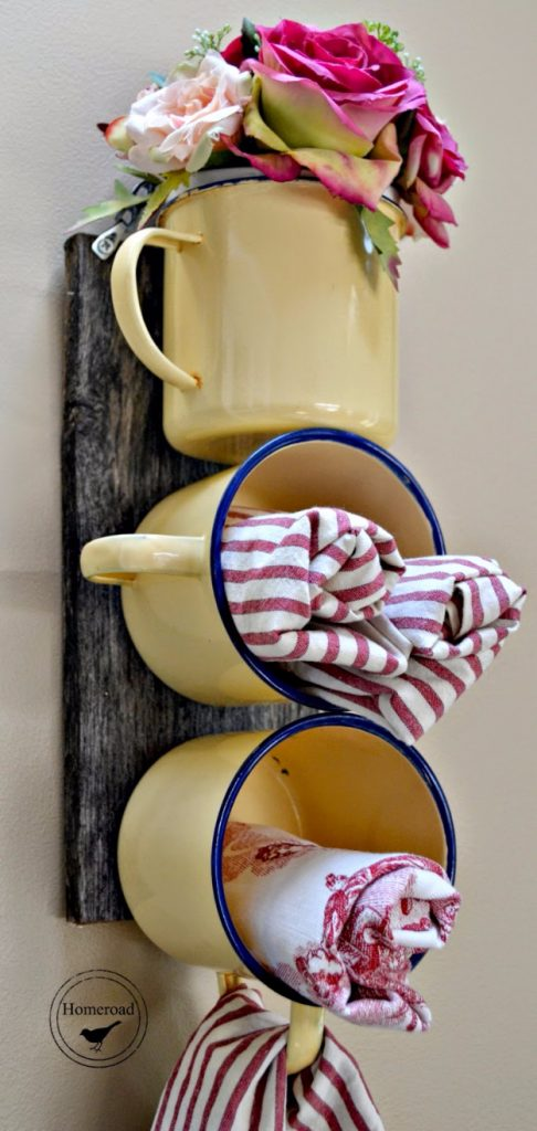 DIY yellow enamel coffee mugs at attached to wood board as storage and flower holder, a perfect DIY rustic farmhouse home decor project when you're on a tight budget