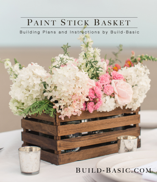 DIY paint stick basket stained and filled with flowers, a perfect DIY rustic farmhouse home decor project when you're on a tight budget