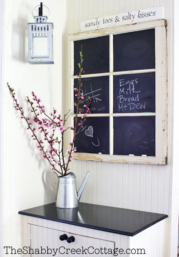 Old window with chalkboard in window panes, as message board hanging on wall, idea for decorating with vintage windows