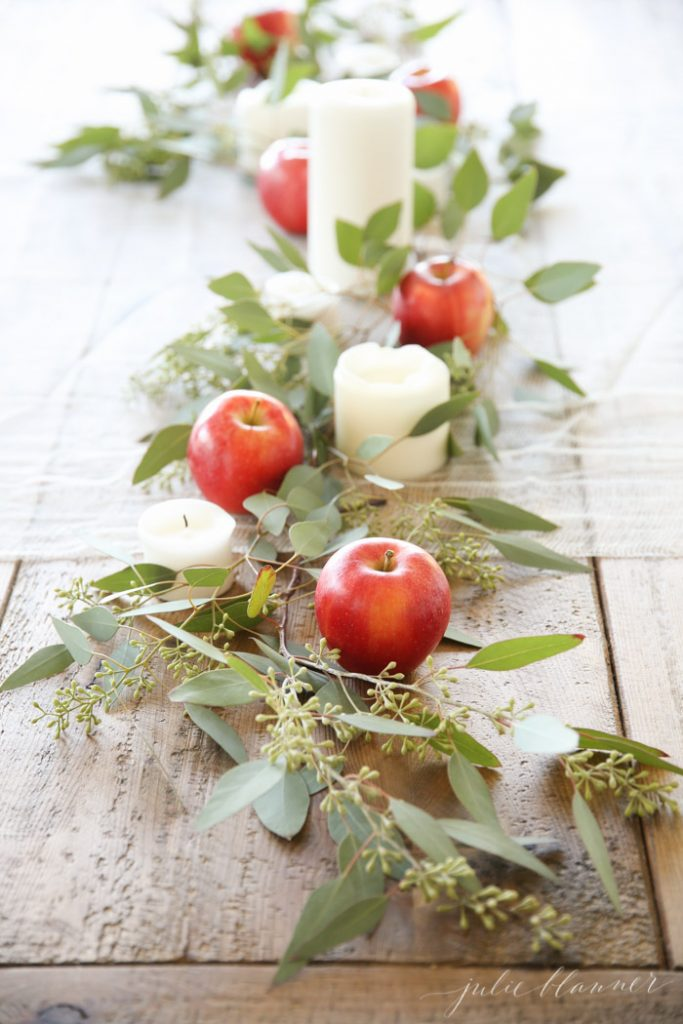 fall apple centerpiece - If you need some inspiration for decorating your home for fall, we've got you covered!  Inside you'll find beautiful ideas for decorating your mantel and fireplace area, your outdoor front porch, and your kitchen and dining area.