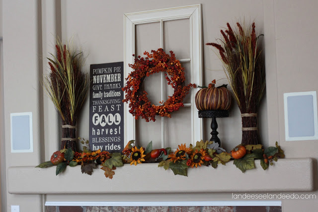 fall decor on mantel with window pane and wreath, black and white word art, wheat bundles and leaf and flower garland