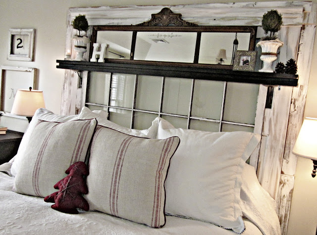 Old window repurposed to create a bed headboard, idea for decorating with vintage windows