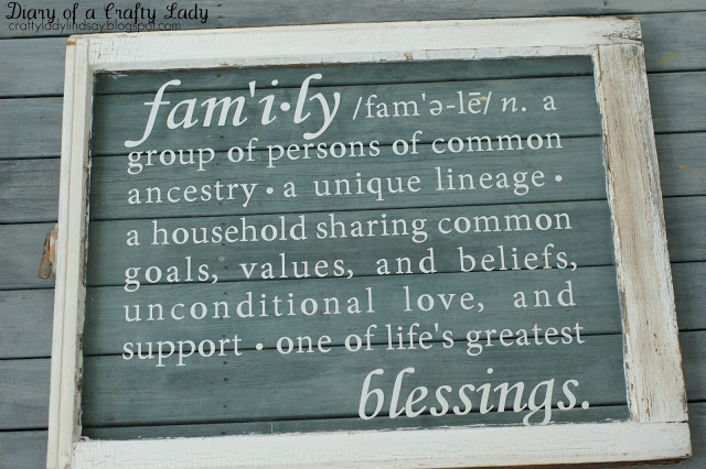 Old window with no panes, with vinyl quote 'family' definition overlay, idea for decorating with vintage windows