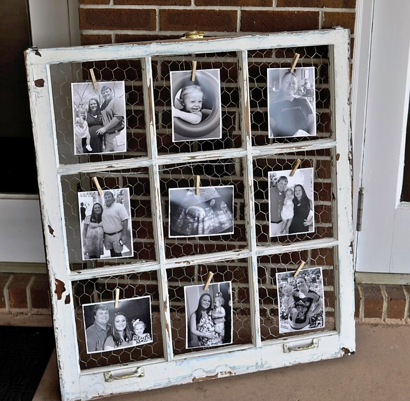 Old window with chicken wire and clothes pins, holding up black and white photos, idea for decorating with vintage windows