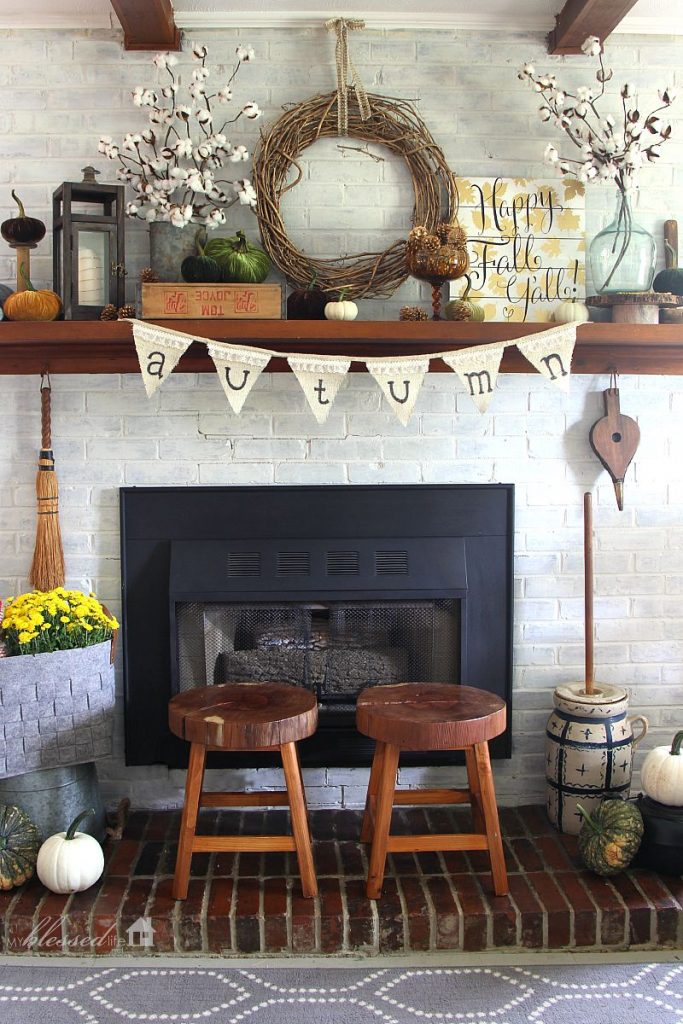 white-washed fall mantel - If you need some inspiration for decorating your home for fall, we've got you covered!  Inside you'll find beautiful ideas for decorating your mantel and fireplace area, your outdoor front porch, and your kitchen and dining area.