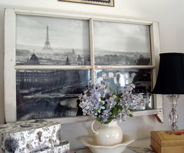 Old window with black and white poster behind it, used as poster frame, idea for decorating with vintage windows
