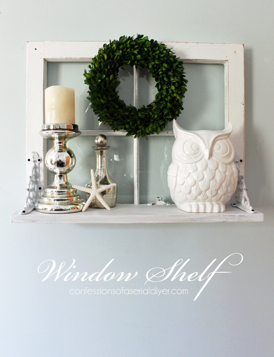 Old window repurposed with shelf, with wreath, candlesticks and decor, idea for decorating with vintage windows