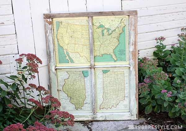 Old window with maps in window panes, idea for decorating with vintage windows