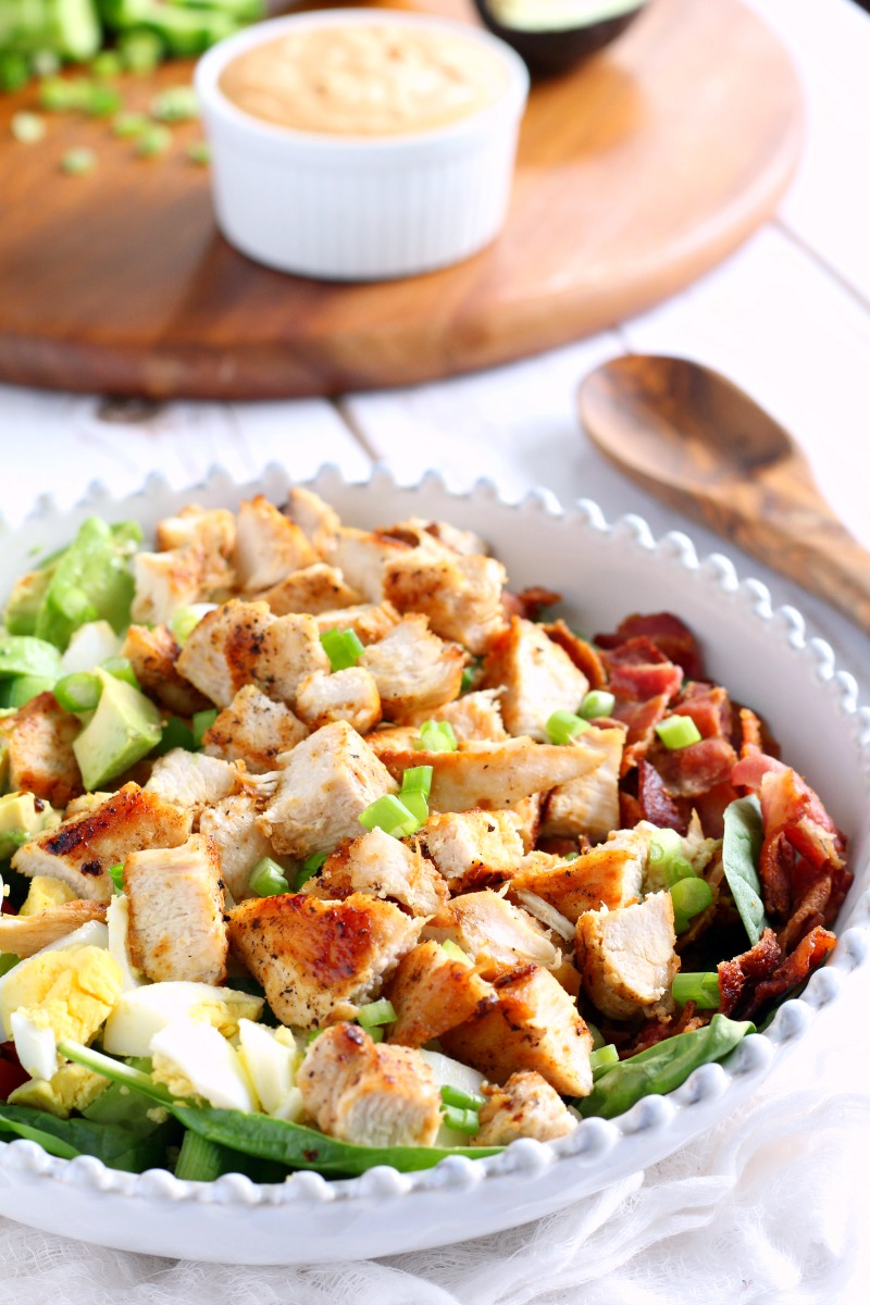 Paleo chicken cobb salad with buffalo ranch dressing on side, salad with chicken, egg, greens, avocado, bacon, one of my favorite Whole30 dinner recipes