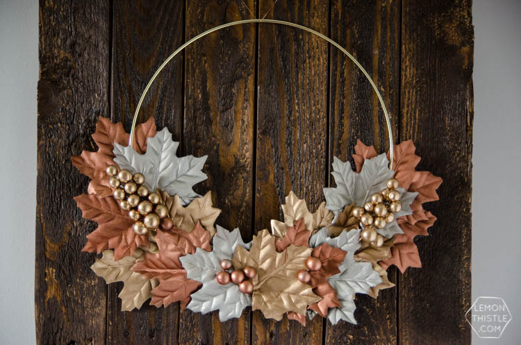 DIY fall wreath with metallic gold, rust, and silver leaves and berries