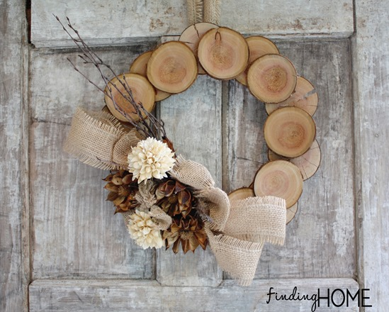 Wood round neutral DIY fall wreath with burlap ribbon and brown and cream flowers