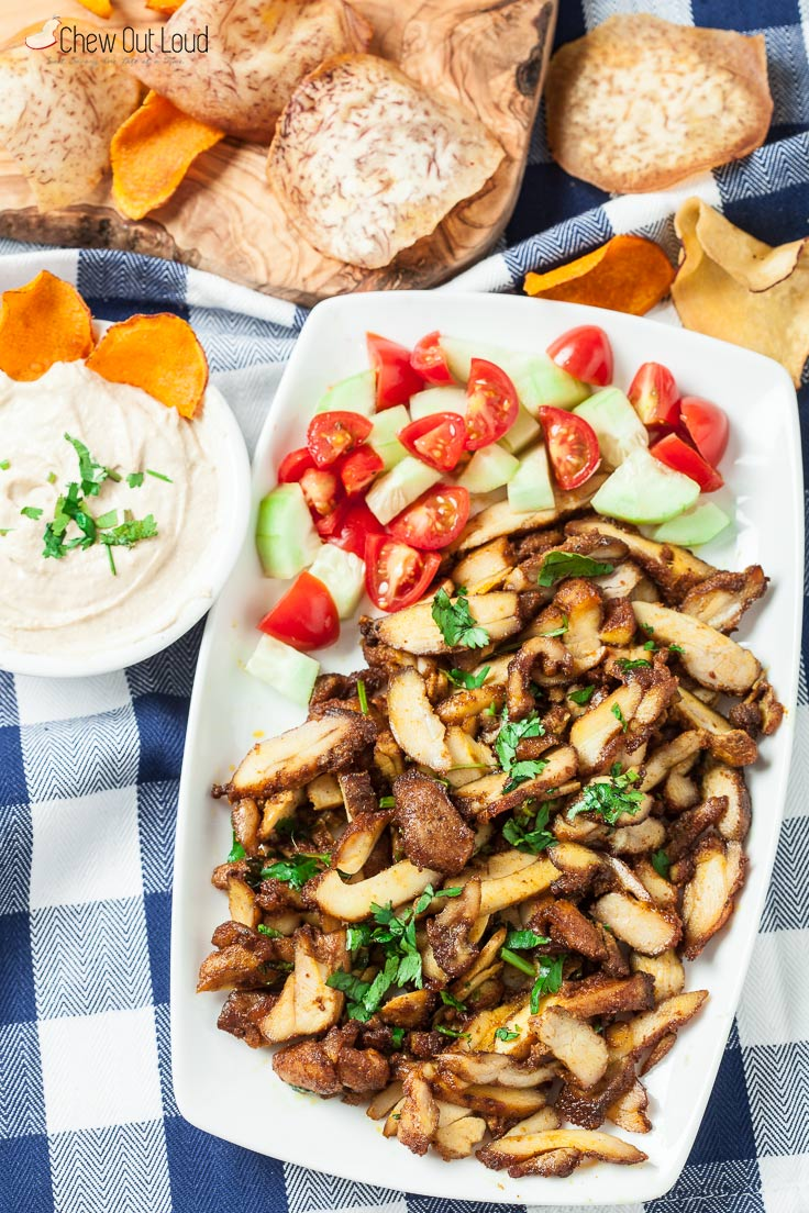 Chicken Shawarma on plate with cucumbers, tomatoes, grain ships and dip, one of my favorite Whole30 dinner recipes