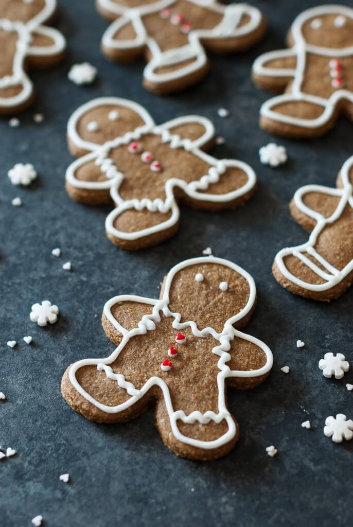 Healthy, clean, paleo gingerbread man cookies laid on baking sheet.