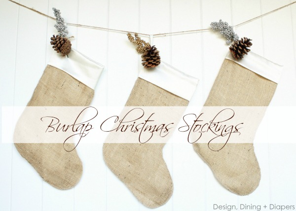 DIY farmhouse Christmas burlap Christmas stockings hung on jute string with pine cones and greens