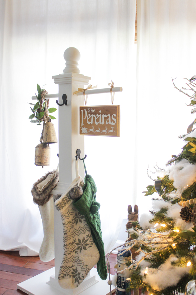 DIY farmhouse Christmas signpost stocking holder with hooks and poles, hanging family sign and stockings