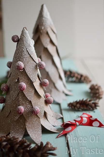 DIY farmhouse Christmas brown paper snow Christmas trees with berries on table