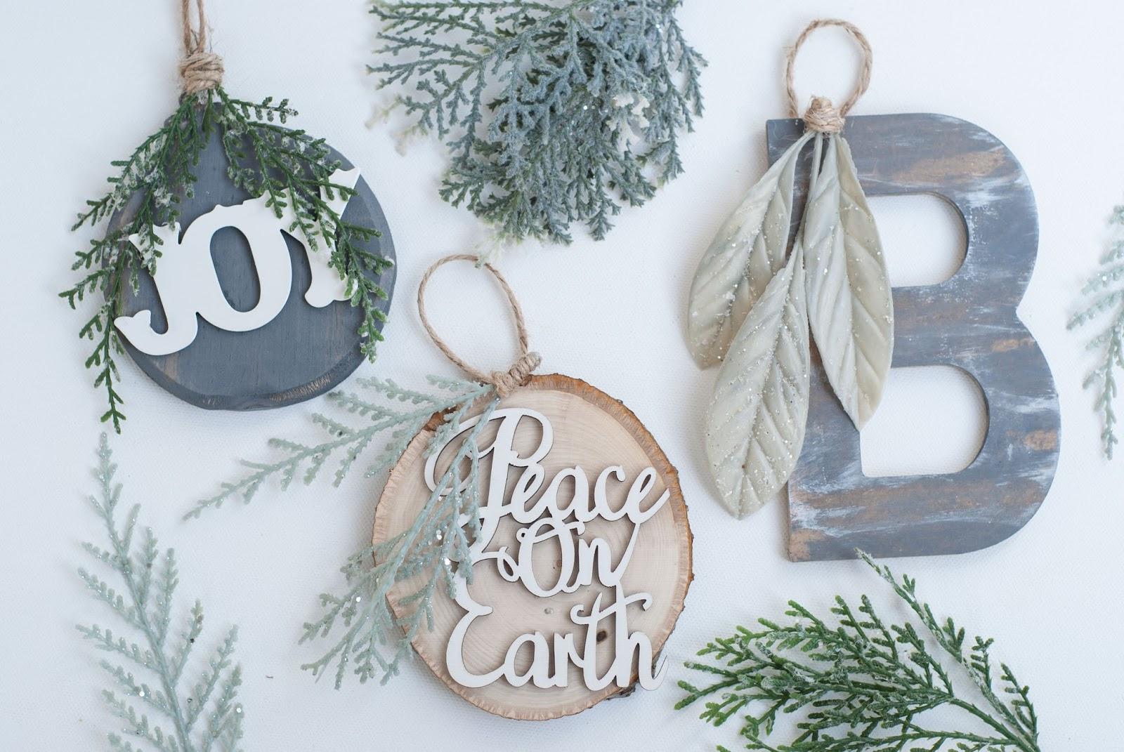 DIY farmhouse Christmas wood slice ornament with JOY, PEACE ON EARTH with pine decor