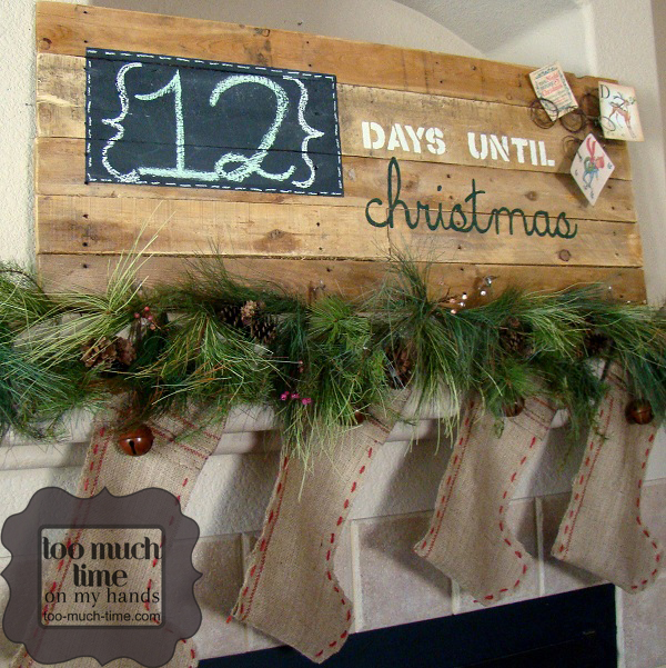 DIY farmhouse Countdown to Christmas Project, reclaimed wood with chalkboard number space on top of mantel with garland and burlap stockings