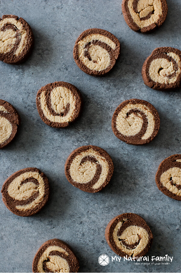 Paleo chocolate peppermint pinwheel Christmas cookies on countertop, a healthy, clean holiday treat!
