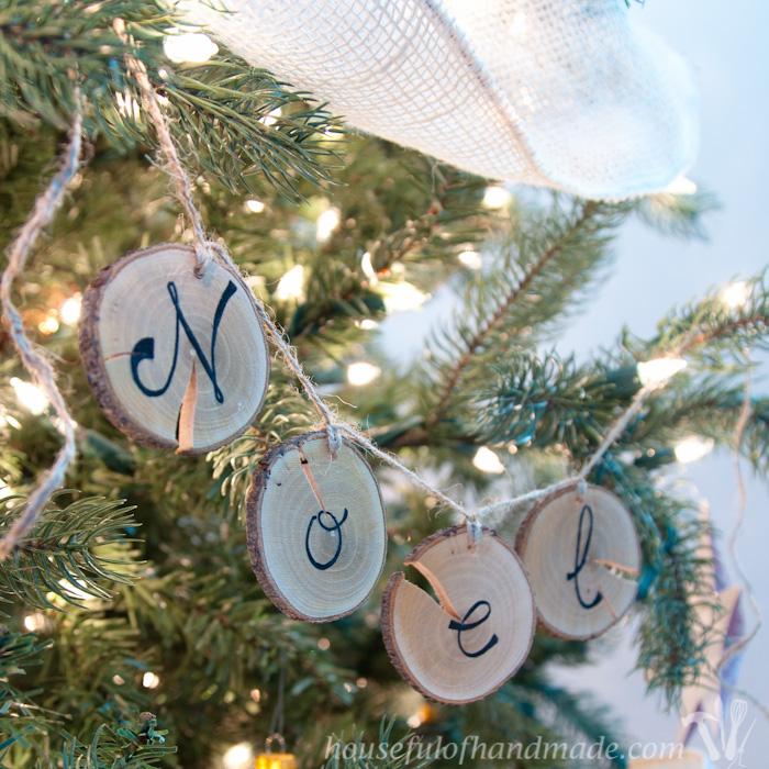 DIY farmhouse Christmas wood slice NOEL banner hanging on Christmas tree