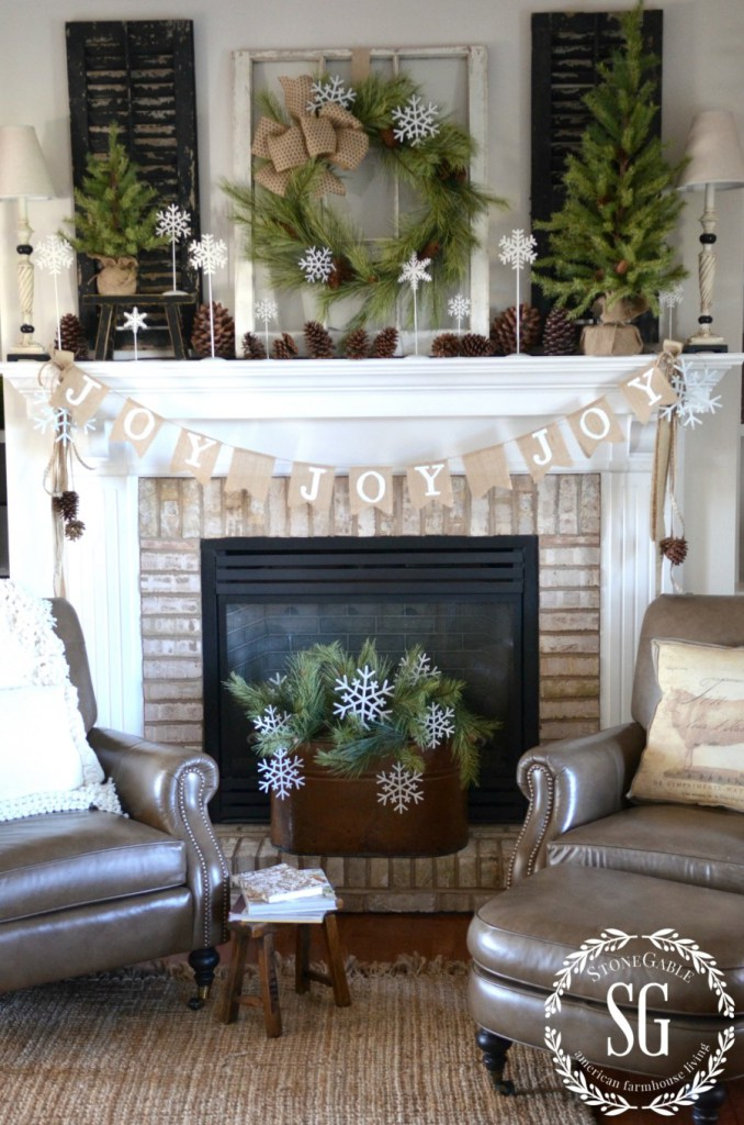Burlap JOY Banner DIY Farmhouse Christmas project on fireplace mantel with wreath on window pane and rustic shutters