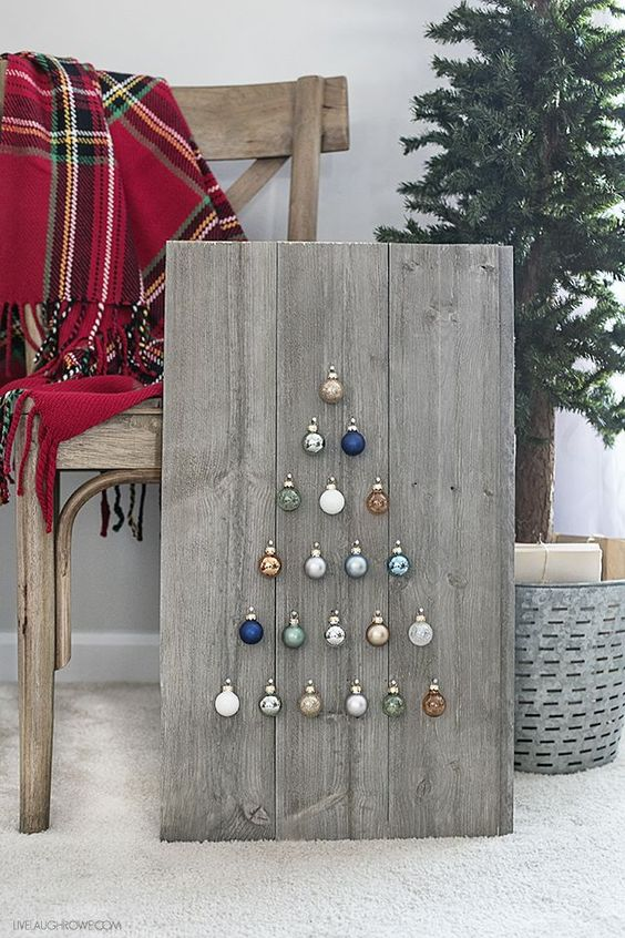 DIY farmhouse Chrismtas project of reclaimed wood with tiny small circle ornaments arranged in Christmas tree shape