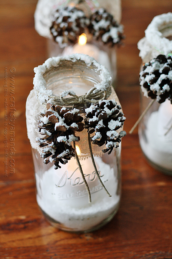 DIY farmhouse Christmas project mason jars with snow covered pine cones attached with jute string, candle holders