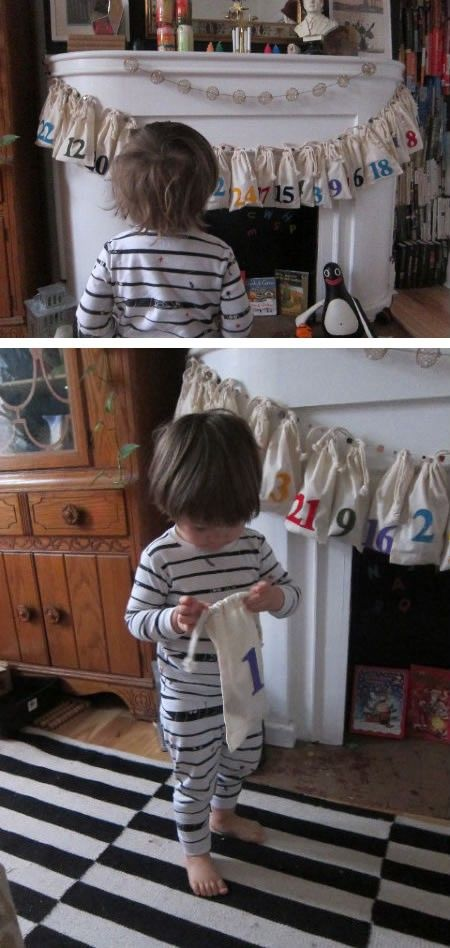 DIY Advent Christmas calendar with medium sized linen sacks hung on a string and numbered, draped over a mantel, with youth child looking on