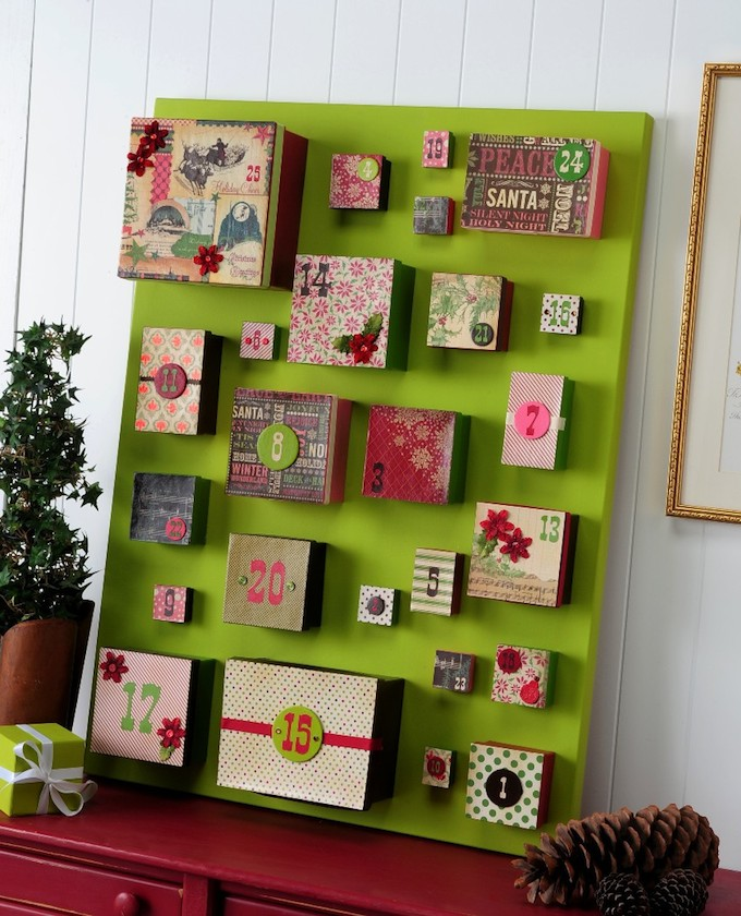 DIY Advent Christmas calendar on lime green background with vintage patterned boxes in various sizes and numbers attached