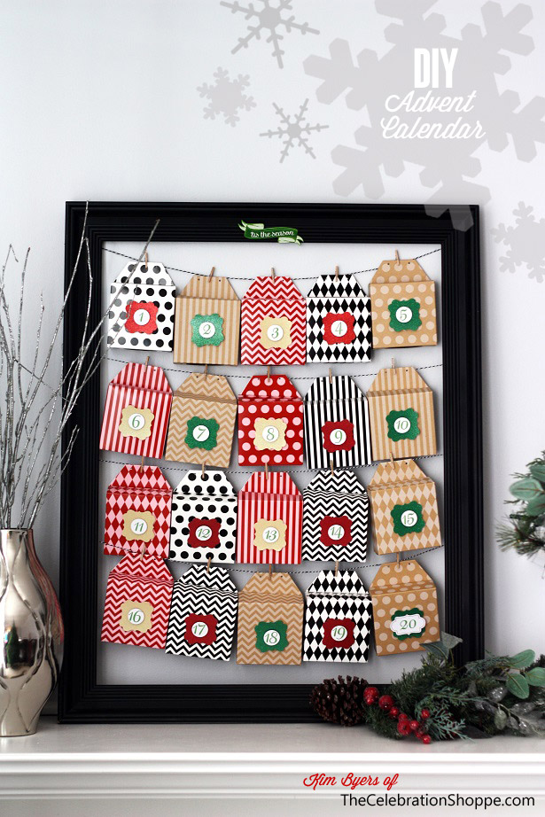 DIY Advent Calender frame with bakers twine strung across and brightly patterned boxed with numbers attached with clips