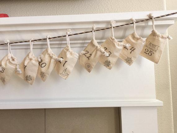 Linen sacks hung on string on mantel, advent calendar from Etsy