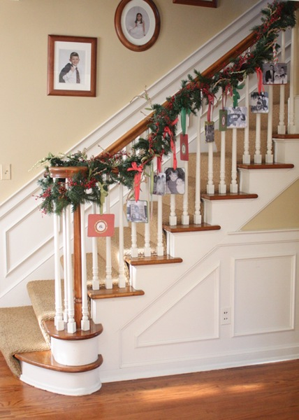 DIY Christmas cardholder display of hole-punched Christmas cards with ribbon attached to garland going down the stair banister