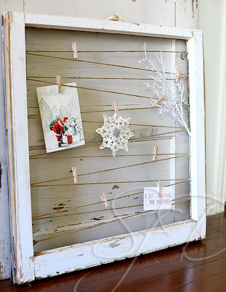 DIY Christmas cardholder display of vintage window without glass, jute string criss-crossed and cards attached with clothes pins