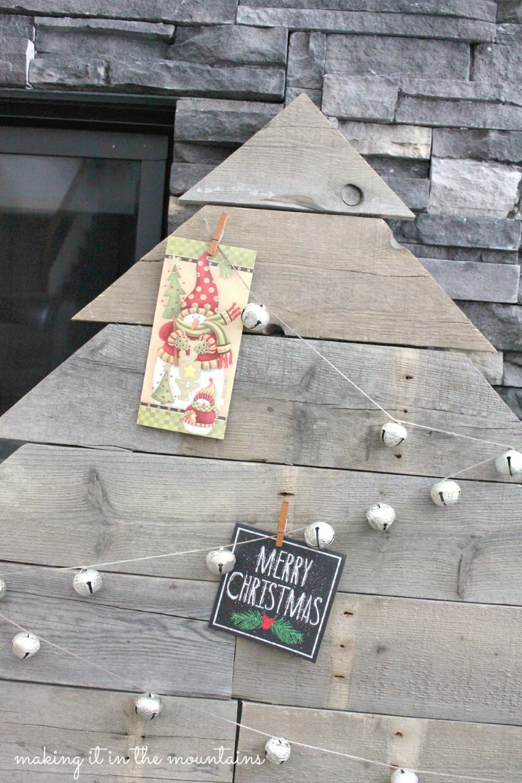 DIY Christmas cardholder display of wooden pallet Christmas tree with jingle bell string criss-crossed and card attached with mini-clothespins