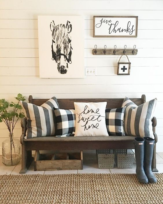 Entryway bench with striped and buffalo check pillows and jute rug