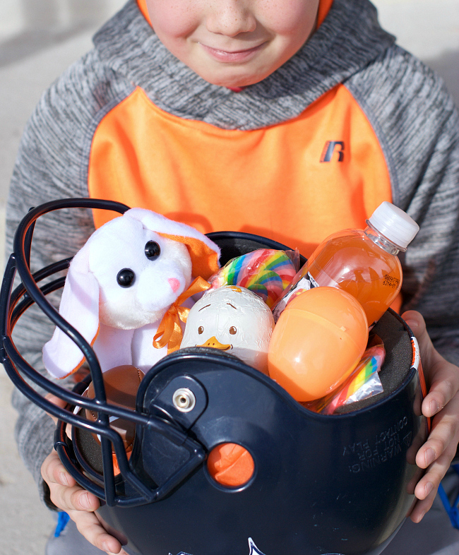 Football helmet Easter basket - If you are looking for something fun and creative and out of the box to use as Easter basket that is not actually a basket, here are 45 brilliant Easter basket ideas that every kid in your house will love!