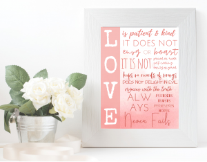 love is patient and kind wall art, pink ombre, in white frame with potted flowers