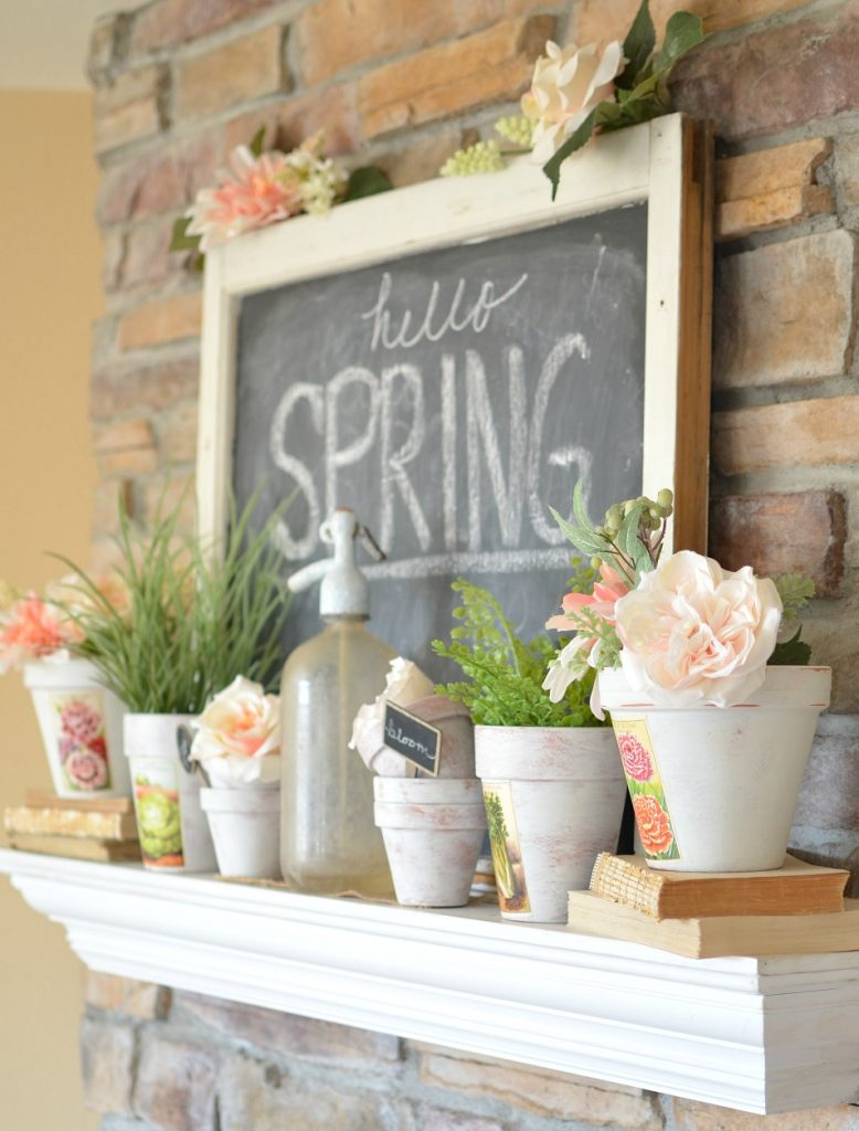 Spring mantel with painted terra cotta pots with flowers, paired with rustic chalkboard, perfect ideas for rustic farmhouse spring home decor