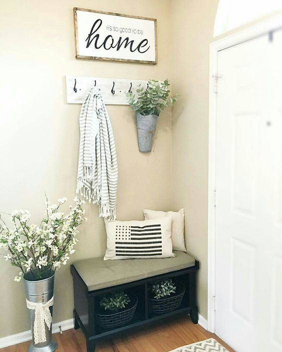Entry bench with basket of flowers below with rustic hook and galvanized buckets with greens and flowers, and 'home' sign, perfect ideas for rustic farmhouse spring home decor