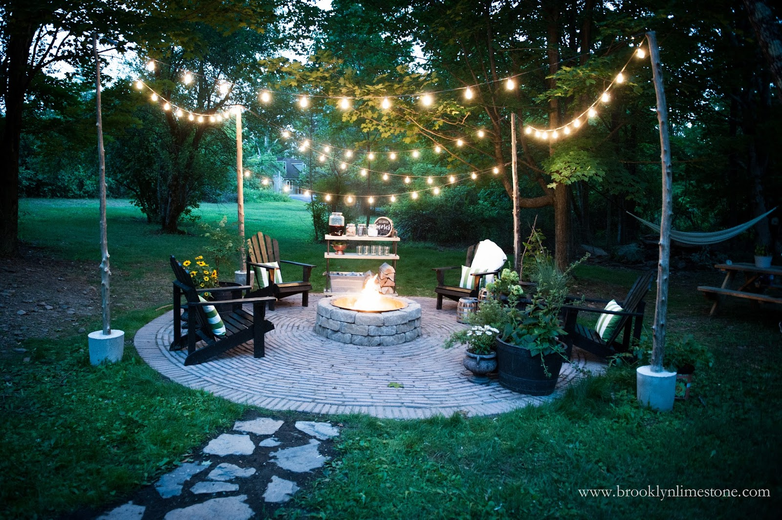 backyard patio firepit seating white string lights - If you are wanting a perfect space to relax and enjoy during the warm summer days, I've got your covered! Inside is EVERYTHING you need to make your backyard and patio your most favorite place the entire summer!