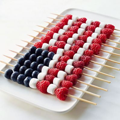 Patriotic Berry fruit kabobs - kabobs with blueberries, raspberries and marshmallows arranged as the American flag