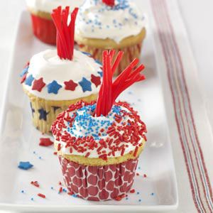 Patriotic Fireworks Cupcakes with red, white, blue sprinkles with Twizzler fireworks coming out of the middle