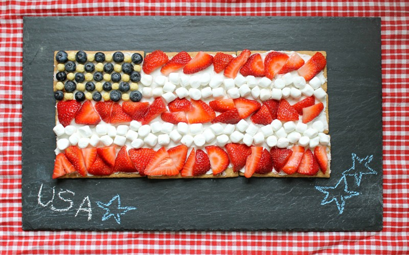 Patriotic Graham Cracker Flag Dessert- Are you looking for easy, delicious, red-white-and-blue desserts to make for Memorial Day or 4th of July?  Here are 30 simple and NO BAKE patriotic desserts and treats you can whip up in a flash!  Keep reading to check out all of the yumminess!